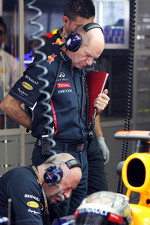 Adrian Newey, Red Bull Racing Chief Technical Officer with Sebastian Vettel, Red Bull Racing in the pits