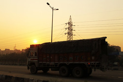 A lorry rumbles along the road in New Delhi