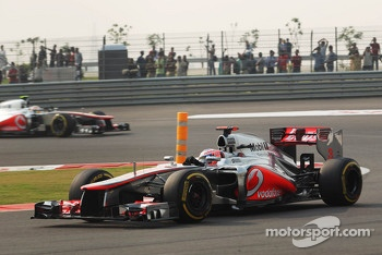 Jenson Button, McLaren Mercedes leads team mate Lewis Hamilton, McLaren Mercedes