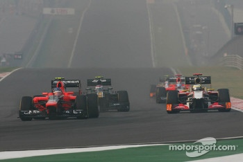 Charles Pic, Marussia F1 Team and Pedro De La Rosa, HRT Formula 1 Team battle for position