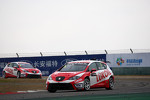 Gabriele Tarquini, SEAT Leon WTCC, Lukoil Racing Team leads Alexey Dudukalo, SEAT Leon WTCC, Lukoil Racing Team
