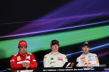 The FIA Press Conference: Fernando Alonso, Ferrari, second; Kimi Raikkonen, Lotus F1 Team, race winner; Sebastian Vettel, Red Bull Racing, third