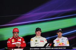 The FIA Press Conference: Fernando Alonso, Ferrari, second; Kimi Raikkonen, Lotus F1 Team, race winner; Sebastian Vettel, Red Bull Racing, third
