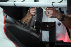 Sauber rear wing worked on by a mechanic
