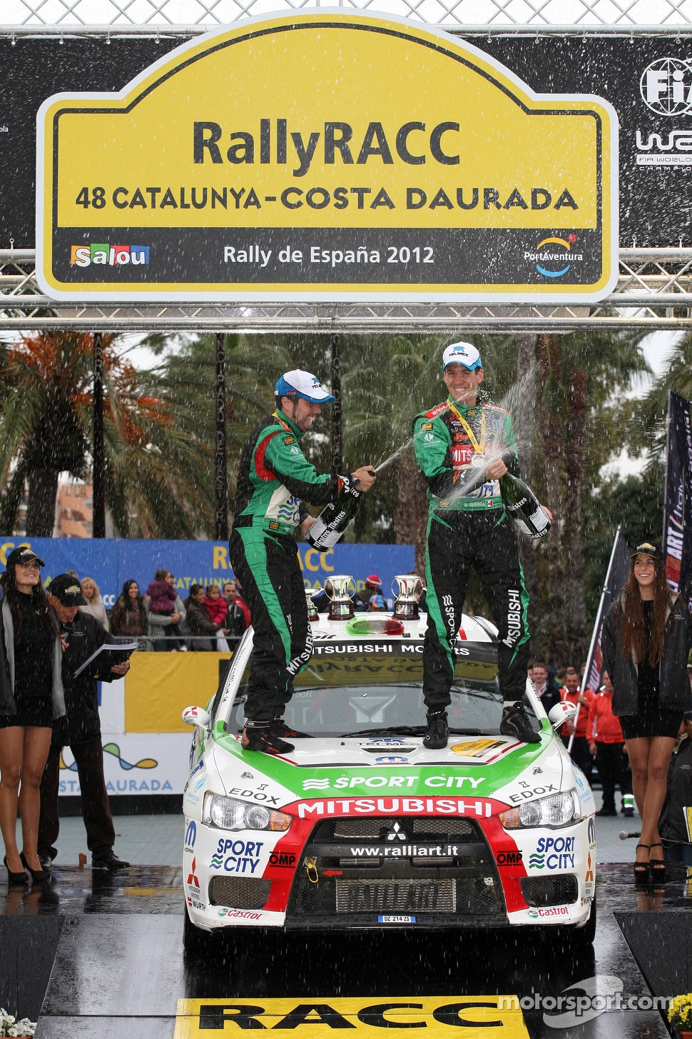 Podium: Benito Guerra and Borja Rozada, Mitsubishi Evo X