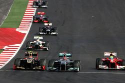Michael Schumacher, Mercedes GP and Romain Grosjean, Lotus F1 Team