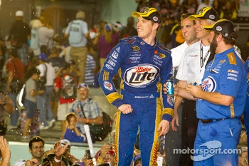 Championship victory lane: 2012 NASCAR Sprint Cup Series champion Brad Keselowski, Penske Racing Dodge sprays fans with beer
