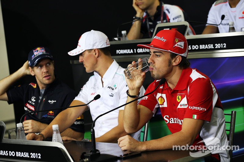 Sebastian Vettel, Red Bull Racing and Michael Schumacher, Mercedes AMG F1 with Fernando Alonso, Ferrari in the FIA Press Conference