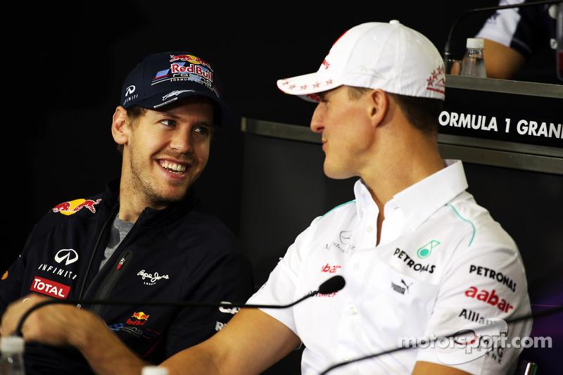 Sebastian Vettel, Red Bull Racing, und Michael Schumacher, Mercedes AMG F1, in der FIA-Pressekonferenz