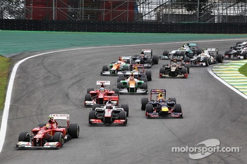 Felipe Massa, Ferrari leads Jenson Button, McLaren and Mark Webber, Red Bull Racing at the start of the race