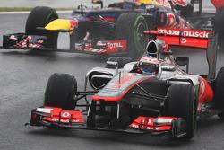 Jenson Button, McLaren leads Mark Webber, Red Bull Racing