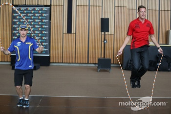 Lee Holdsworth and James Courtney taking part in the Ford vs Holden challenge