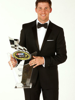 Denny Hamlin with the sixth place trophy