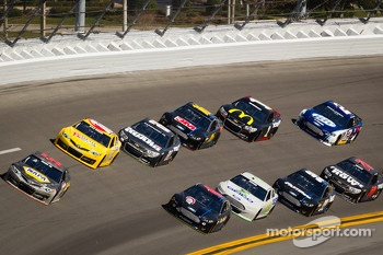 Martin Truex Jr., Michael Waltrip Racing Toyota leads the pack