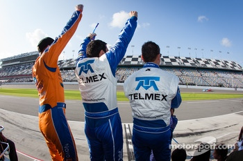 Charlie Kimball, Memo Rojas and Scott Pruett celebrate as Juan Pablo Montoya crosses the finish line