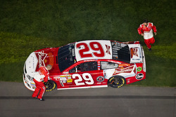 Richard Childress Racing team members run to the stalled car of Kevin Harvick, Richard Childress Racing Chevrolet