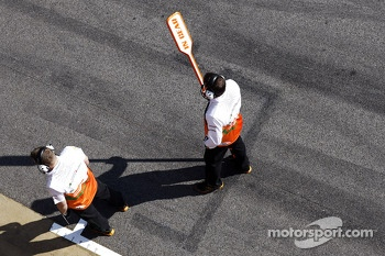 Sahara Force India F1 Team mechanic with pit stop lollipop