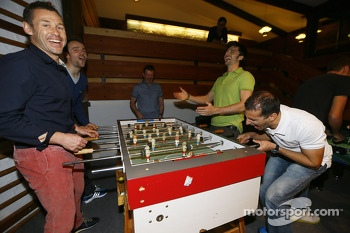 Tom Kristensen, Jamie Green, Marco Bonanomi and Marc Gene play foosball