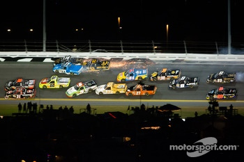 German Quiroga, Brennan Newberry and Brendan Gaughan touch, which starts a huge wreck in turn 3