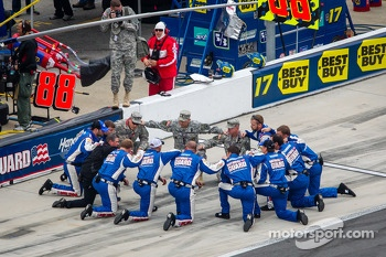 Hendrick Motorsports Chevrolet crew members confer before the race