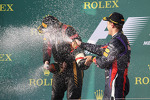 Race winner Kimi Raikkonen, Lotus F1 Team celebrates on the podium with Sebastian Vettel, Red Bull Racing