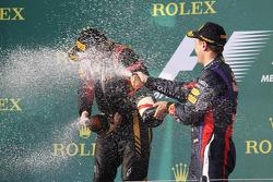 Race winner Kimi Raikkonen, Lotus F1 Team celebrates on the podium with Sebastian Vettel, Red Bull Racing