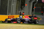 Sergio Perez, McLaren MP4-28 and Sebastian Vettel, Red Bull Racing RB9 battle for position