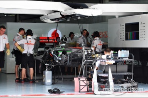 McLaren MP4-28 is prepared in the pits