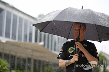 Kimi Raikkonen, Lotus F1 Team during a storm