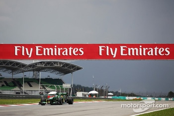 Giedo van der Garde, Caterham CT03 passes under Fly Emirates hoardings