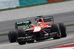 Jules Bianchi, Marussia F1 Team MR02 leads Giedo van der Garde, Caterham CT03.