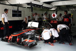 The McLaren MP4-28 of Sergio Perez, McLaren MP4-28 is worked on in the pits