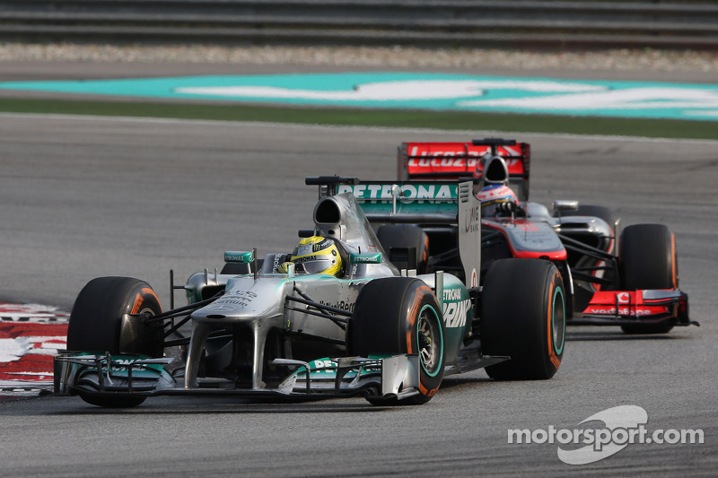 Nico Rosberg, Mercedes AMG F1 W04 leads Jenson Button, McLaren MP4-28