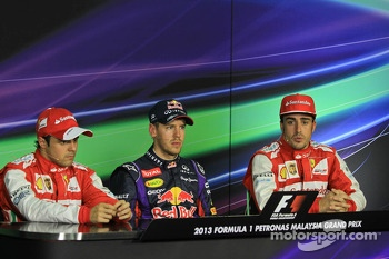 Polesitter Sebastian Vettel, Red Bull Racing RB9, second place Felipe Massa, Ferrari F138, third place Fernando Alonso, Ferrari F138