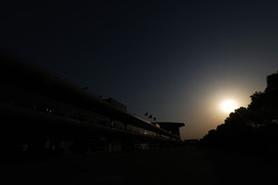 The sun sets over the paddock