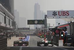 Daniel Ricciardo, Scuderia Toro Rosso STR8 and Adrian Sutil, Sahara Force India VJM06 leave the pits