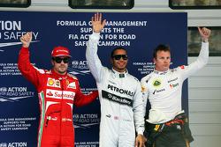 The top three qualifiers in Parc Ferme, Ferrari, third; Lewis Hamilton, Mercedes AMG F1, pole position; Kimi Raikkonen, Lotus F1 Team, second
