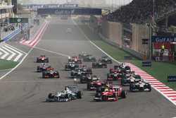 Nico Rosberg, Mercedes AMG F1 W04 and Fernando Alonso, Ferrari F138 lead at the start of the race