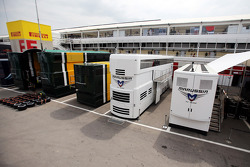 Marussia F1 Team trucks in the paddock