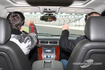 Michael Andretti and Kurt Busch drive the track