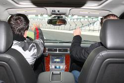 Michael Andretti and Kurt Busch drive the track