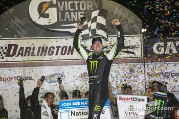 Podium: race winner Kyle Busch celebrates