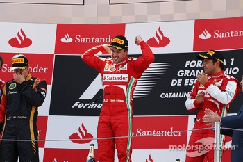 The podium, Lotus F1 Team, second; Fernando Alonso, Ferrari, race winner; Felipe Massa, Ferrari, third
