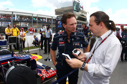 Christian Horner, Red Bull Racing Team Principal with Adam Cooper, Journalist on the grid