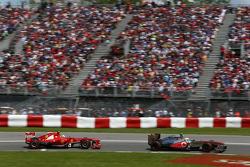 Sergio Perez, McLaren MP4-28 leads Felipe Massa, Ferrari F138