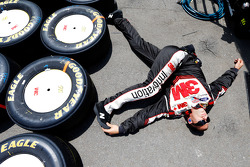 A Roush-Fenway crew member stretches