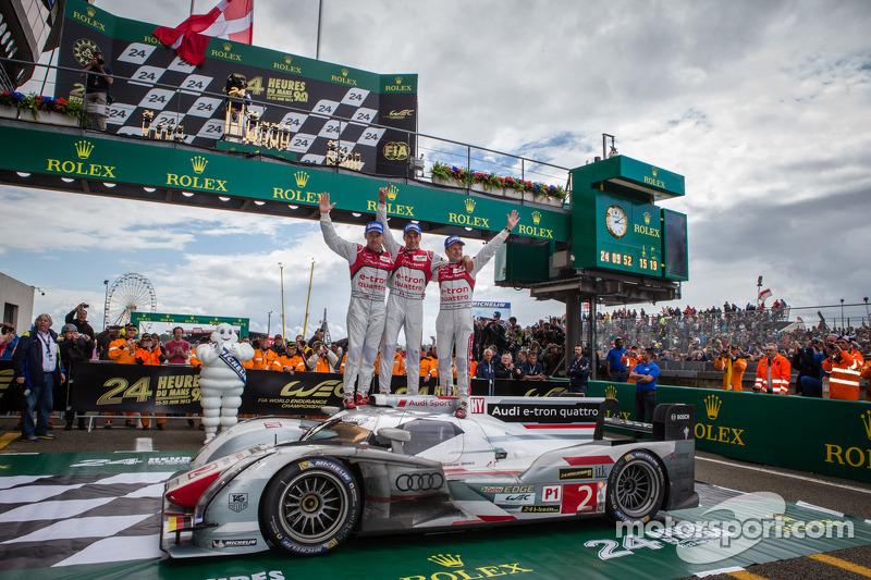 Race winners Tom Kristensen, Allan McNish and Loic Duval celebrate