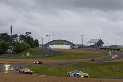 The field bunches up under one of the many safety car periods