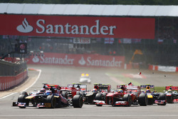 Mark Webber, Red Bull Racing RB9 makes contact with Romain Grosjean, Lotus F1 E21 at the start of the race