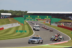 Sebastian Vettel Red Bull Racing RB9 leads behind the FIA Safety Car